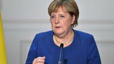 Меркель назвала поведение России агрессивным